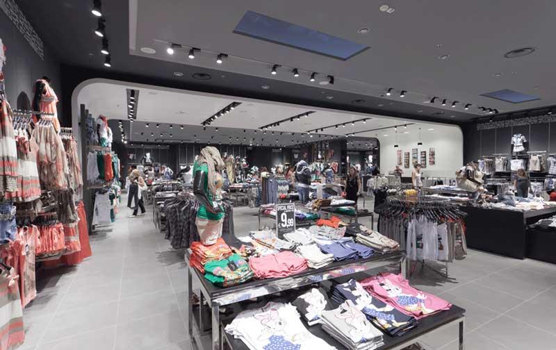 SPINADESIGN arredamento punti vendita Candida abbigliamento