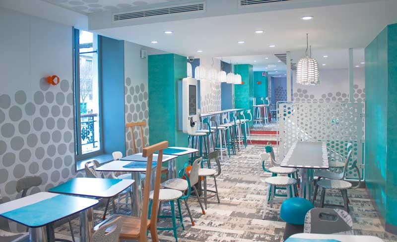 Paola Navone  sceglie laminati abet per decorare pareti porte tavoli dei McDonald's France