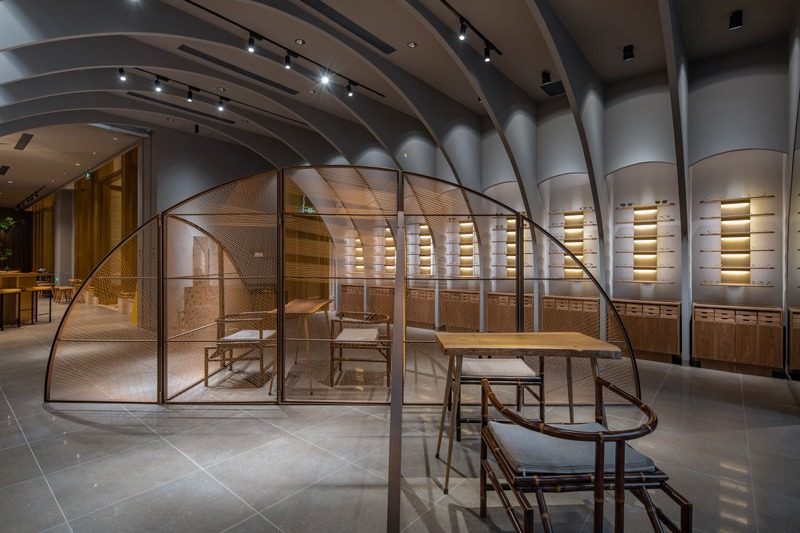 Beijing-based architecture Studio TEMP has designed an optical store combined with a cafe in Financial Street, Beijing