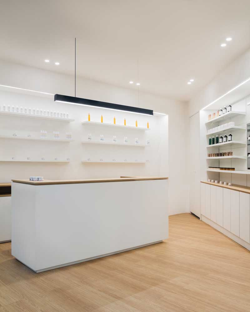 Inside the old town centre of Palermo the design Agency Alva Architetti projects the interior and the branding of the ParaPharmacy della Marina